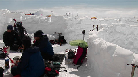 Climbers eating at camp Stock Video Footage