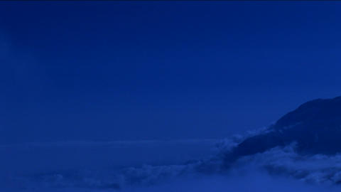 View of clouds in blue light Footage
