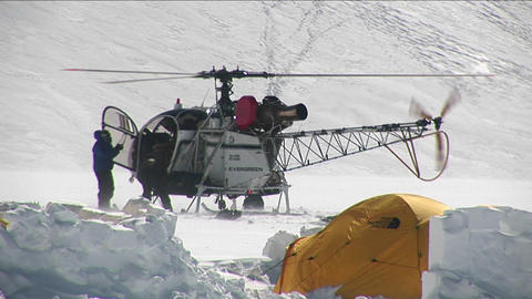 Helicopter on glacier Stock Video Footage