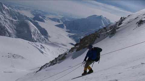 Climber carefully descending steep slope Stock Video Footage