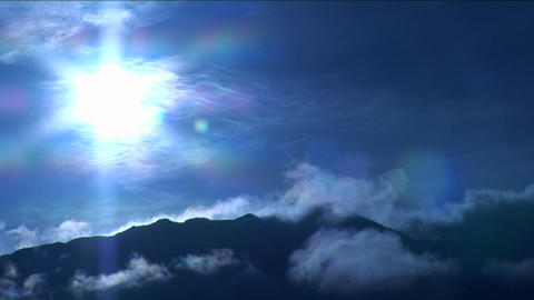 Mountain in the clouds under blue light Stock Video Footage