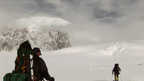 Climbers headed out over snow Stock Video Footage