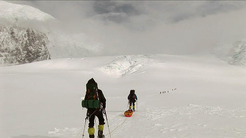 Climbers headed out over snow Footage