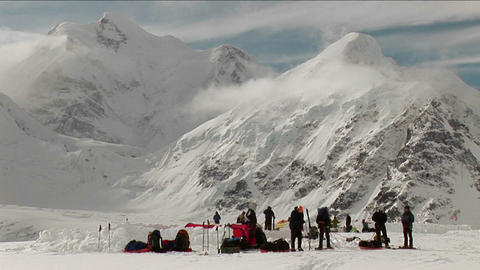 Climbers prepare to leave camp Stock Video Footage