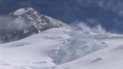 Pan of mountain and climbers making there way up Stock Video Footage