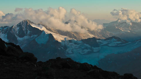 Sun and cloud moving over Caucasus Mountains Stock Video Footage