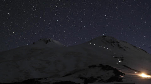 Climbers making there way up Mount Elbrus as sun rises Stock Video Footage