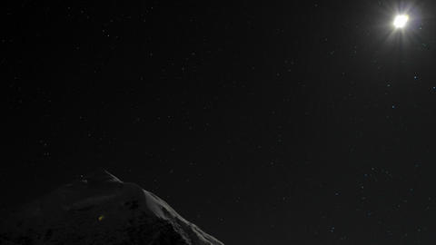 Moon passing over Himalayan peak Stock Video Footage