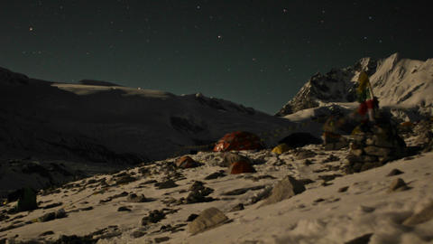 Tents at basecamp as moon sets, camp goes dark Stock Video Footage