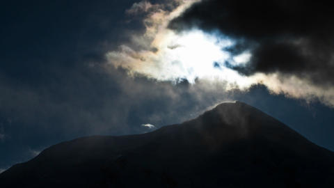 Mount Hunter with cloud cover and sun Stock Video Footage