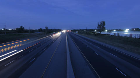 Cars at dusk on highway Stock Video Footage