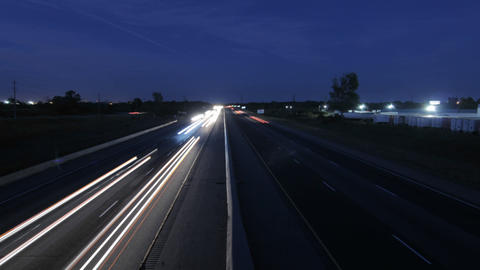 Cars at dusk on highway Footage