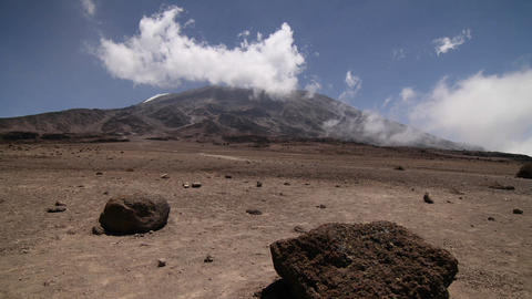 Kilimanjaro from a distance, trekker crosses Stock Video Footage