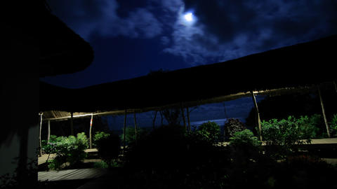 Hotel at night with moon overhead Footage