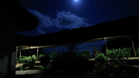 Hotel at night with moon overhead Stock Video Footage