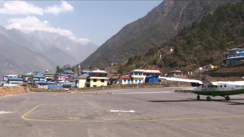 Plane taxing down Lukla runway Stock Video Footage