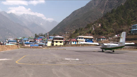 Plane taxing down Lukla runway Footage