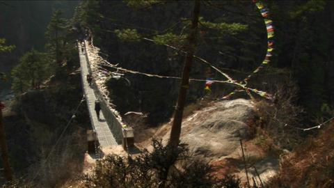 Crossing large suspension bridge over gorge Stock Video Footage