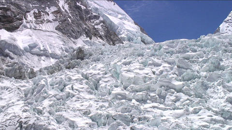 Pan of icefall with climbers Stock Video Footage