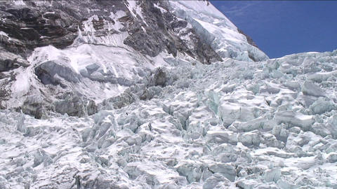 Pan of icefall with climbers Footage