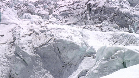 Pan up with climbers in Khumbu icefall Stock Video Footage