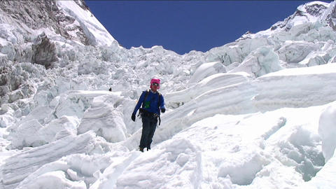 Pan from peak to Sherpa coming down icefall Footage