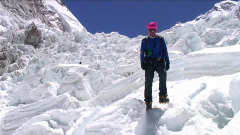 Pan from peak to Sherpa coming down icefall Stock Video Footage