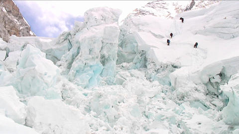 Climbers dwarfed by ice formations Stock Video Footage