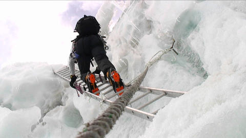 Climber descends ladder Stock Video Footage