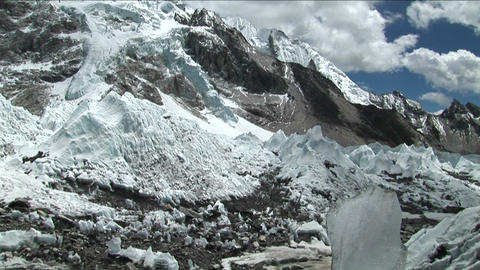 Tilt down from peak to glacial stream Stock Video Footage