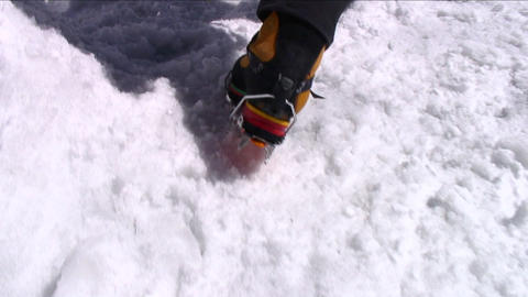 Crampons digging into snow as climber ascends Footage