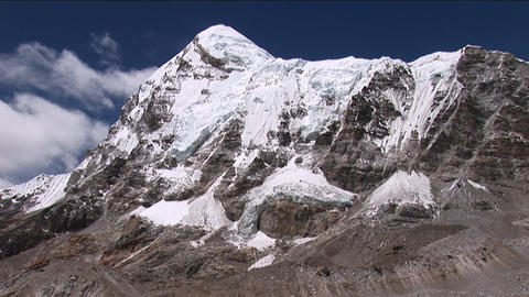 Pumori tilt down to base camp, birds fly by Footage