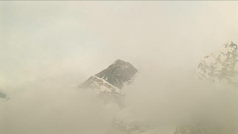 Zoom in on Everest through the clouds Stock Video Footage