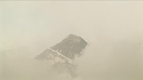 Zoom in on Everest through the clouds Footage