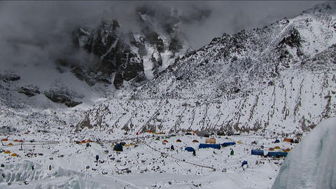 Wide shot pan of snowy Everest Basecamp Stock Video Footage