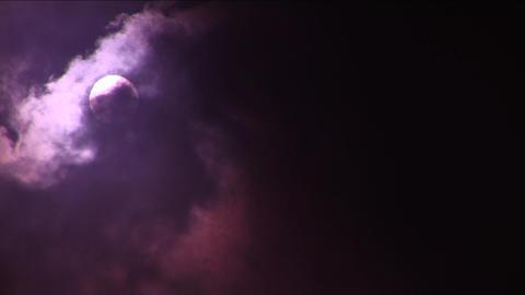 Clouds cover sun, dark reddish sky Footage