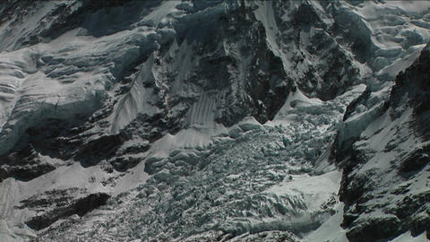 Pan from basecamp through icefall to Everest summit Stock Video Footage