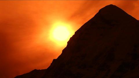Setting sun silhouetting Pumori Stock Video Footage
