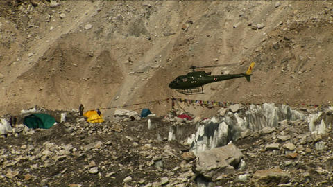 Helicopter leaving basecamp Stock Video Footage