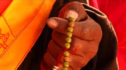 Close-up of Lama using prayer beads Stock Video Footage