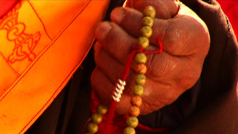 Close-up of Lama using prayer beads Footage