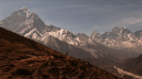 Wide shot of trail to basecamp with trekker walking Stock Video Footage