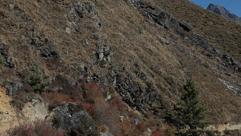 Pan of trail leading to Dingboche stupa Stock Video Footage