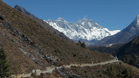 Pan of trail leading to Dingboche stupa Footage