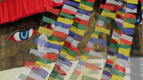 Prayer flags streaming in front of Adi Buddha Stock Video Footage