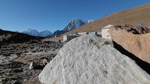 Gorakshep from behind stones Stock Video Footage