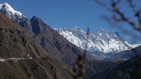 Glide revealing Dingboche stupa, Everest & Lhotse Stock Video Footage