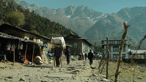 Porters walking down trail in Lukla Stock Video Footage