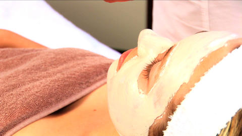 Young blonde girl resting after having facial skin mask... Stock Video Footage