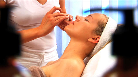 Young blonde girl having facial treatment at beauty spa... Stock Video Footage